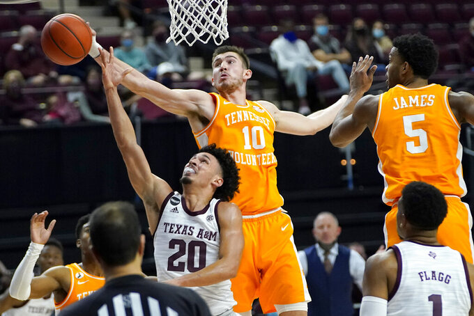 Tennessee forward John Fulkerson (10) blocks a shot by Texas A&M guard Andre Gordon (20) during the second half of an NCAA college basketball game Saturday, Jan. 9, 2021, in College Station, Texas. (AP Photo/Sam Craft)
