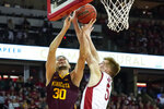 Minnesota's Alihan Demir (30) shoots against Wisconsin's Tyler Wahl (5) during the first half of an NCAA college basketball game Sunday, March 1, 2020, in Madison, Wis. (AP Photo/Andy Manis)