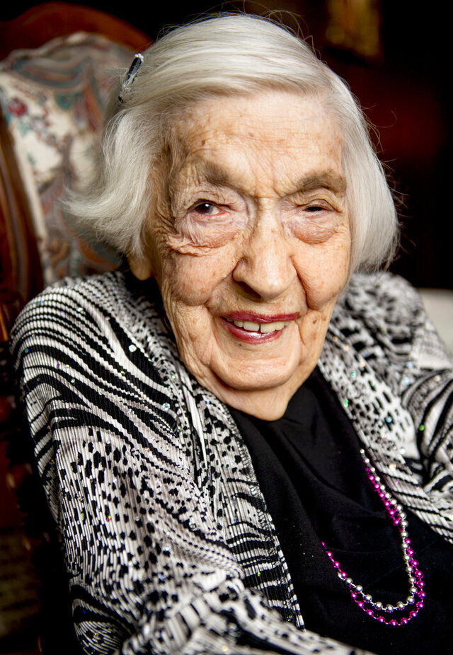 MacCene Grimmett, 106, poses for a portrait at her home in Provo, Utah, on Thursday, June 11, 2020. Grimmett was born on Friday, June 13, 1913, and will turn 107, Saturday, June 13, 2020. (Isaac Hale/The Daily Herald via AP)