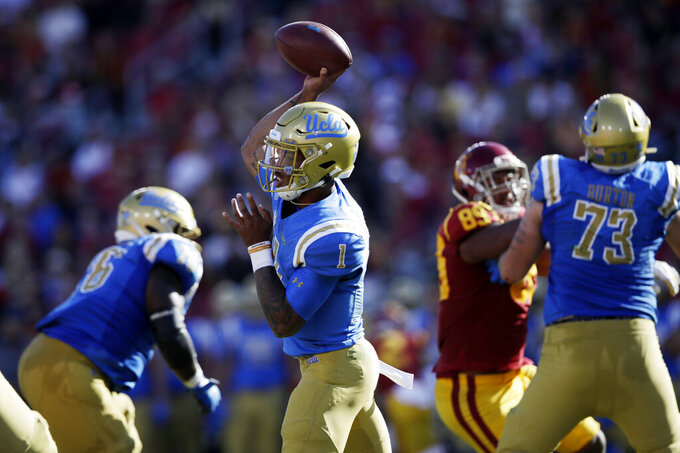 UCLA quarterback Dorian Thompson-Robinson (1) throws against Southern California during the first half of an NCAA college football game, Saturday, Nov. 23, 2019, in Los Angeles. (AP Photo/Marcio Jose Sanchez)