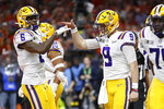 LSU quarterback Joe Burrow, right, celebrates with wide receiver Terrace Marshall Jr. after scoring against Clemson during the first half of a NCAA College Football Playoff national championship game Monday, Jan. 13, 2020, in New Orleans. (AP Photo/Gerald Herbert)