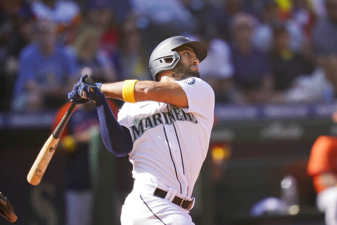 Seattle Mariners' Abraham Toro connects on a sacrifice fly to score a run against the Houston Astros in the sixth inning of a baseball game Wednesday, Sept. 1, 2021, in Seattle. (AP Photo/Elaine Thompson)