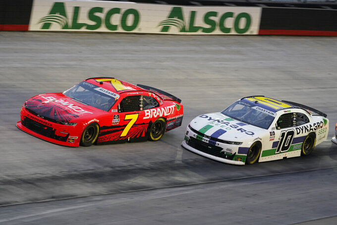 Justin Allgaier (7) and Ross Chastain (10) drive into Turn 1 during the NASCAR Xfinity Series auto race Friday, Sept. 18, 2020, in Bristol, Tenn. (AP Photo/Steve Helber)