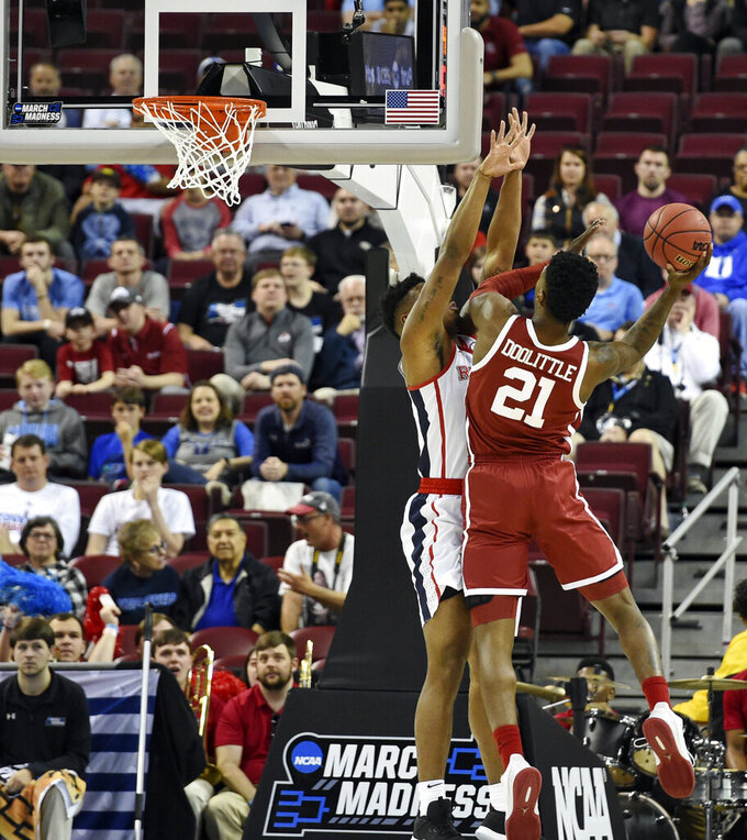 Oklahoma's Kristian Doolittle (21) shoots over Mississippi's Bruce Stevens during of a first-round game in the NCAA men's college basketball tournament in Columbia, S.C. Friday, March 22, 2019. (AP Photo/Richard Shiro)