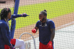 Atlanta Braves' Ozzie Albies, right, laughs with Ronald Acuña Jr. before batting during team baseball practice at Truist Park, Sunday, July 5, 2020, in Atlanta. (AP Photo/Brynn Anderson)