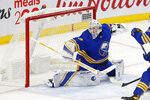 Buffalo Sabres goalie Linus Ullmark (35) makes a save during the third period of an NHL hockey game against the New York Rangers, Tuesday, Jan. 26, 2021, in Buffalo, N.Y. (AP Photo/Jeffrey T. Barnes)
