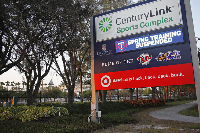 "A sign outside Hammond Stadium reads ""spring training suspended"" after a baseball game was cancelled between the Minnesota Twins and the Baltimore Orioles, Thursday, March 12, 2020, in Fort Myers, Fla. Major League Baseball has suspended the rest of its spring training game schedule because if the coronavirus outbreak. MLB is also delaying the start of its regular season by at least two weeks. (AP Photo/Elise Amendola)"