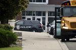 Warren Police patrol Warren Fitzgerald High School after a student was stabbed at the school, on Wednesday, Sept. 12, 2018, in Warren, Mich. (Max Ortiz/Detroit News via AP)