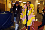 Rapper Remy Ma, whose real name is Reminisce Smith, leaves Manhattan criminal court, with her husband Shamele Mackie, whose stage name is Papoose, in New York, Monday, Dec. 2, 2019. She's accused of punching her