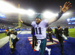 Philadelphia Eagles quarterback Carson Wentz (11) runs off after the Eagles beat the New York Giants, 34-17, on Sunday, Dec. 29, 2019, in East Rutherford, N.J. The victory clinched the NFC East division title for the Eagles. (Andrew Mills/NJ Advance Media via AP)