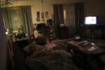 Jacob Olivas sleeps on the couch with the television and lights left on in his mobile home in Rancho Cucamonga, Calif. on Saturday, Sept. 28, 2019. Olivas is afraid of the dark, and of being alone. Each night he settles onto the couch and tries to fall asleep to the hum of the television. Sometimes it works, sometimes he's startled awake by nightmares, likely from so many years of keeping what happened to himself. (AP Photo/Wong Maye-E)