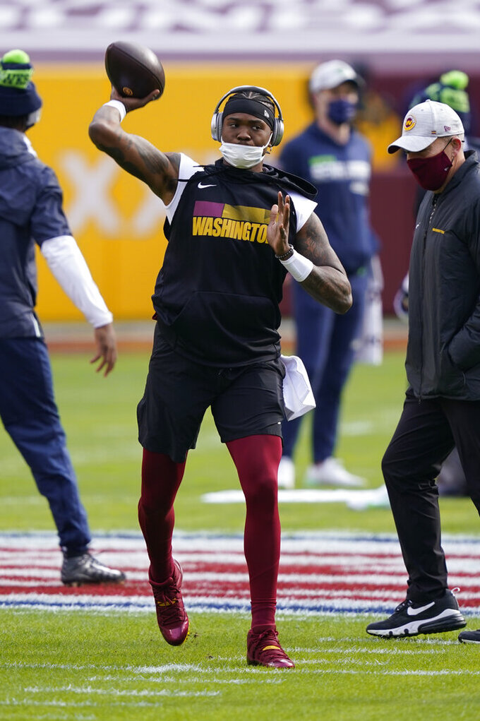 Washington Football Team quarterback Dwayne Haskins (7) warming up before the start of an NFL football game against the Seattle Seahawks, Sunday, Dec. 20, 2020, in Landover, Md. (AP Photo/Susan Walsh)