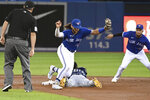 Tampa Bay Rays' Randy Arozarena slides safely into second with a stolen base ahead of the throw to Toronto Blue Jays' Bo Bichette, middle, during the second inning of a baseball game Tuesday, Sept. 14, 2021, in Toronto. (Jon Blacker/The Canadian Press via AP)