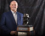 "Fresno State coach Jeff Tedford poses for a photograph with the Paul ""Bear"" Bryant Coach of the Year Award, before the ceremony Wednesday, Jan. 9, 2019, in Houston. (Yi-Chin Lee/Houston Chronicle via AP)"