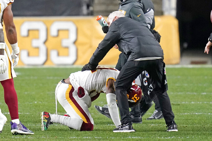 Washington Football Team strong safety Kamren Curl (31) is helped by a team trainer during the second half of an NFL football game against the Pittsburgh Steelers, Monday, Dec. 7, 2020, in Pittsburgh. (AP Photo/Keith Srakocic)