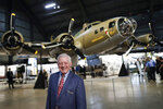 Robert K. Morgan, Jr., son of the Memphis Belle pilot of the same name, walks past the Boeing B-17