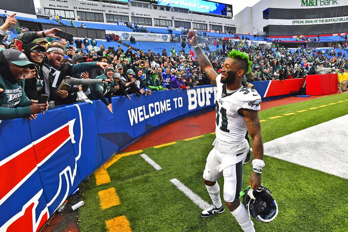Philadelphia Eagles' Jalen Mills celebrates with fans after an NFL football game against the Buffalo Bills, Sunday, Oct. 27, 2019, in Orchard Park, N.Y. (AP Photo/Adrian Kraus)