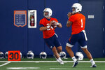 Quarterbacks Cord Sandberg (24) and Joey Gatewood (1) throw the ball during Auburn's first practice, Friday, Aug. 2, 2019, in Auburn, Ala. (AP Photo/Butch Dill)