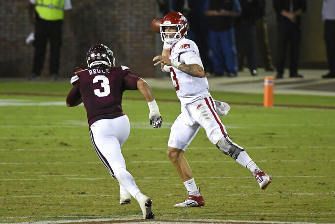 Arkansas quarterback Feleipe Franks (13) releases a pass past Mississippi State linebacker Aaron Brule (3) during the first half of an NCAA college football game in Starkville, Miss., Saturday, Oct. 3, 2020. (AP Photo/Thomas Graning)