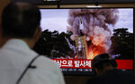 People watch a TV news program reporting North Korea's firing projectiles with a file image at the Seoul Railway Station in Seoul, South Korea, Saturday, Aug. 24, 2019. North Korea fired two suspected short-range ballistic missiles off its east coast on Saturday in the seventh consecutive week of weapons tests, South Korea's military said, a day after it threatened to remain America's biggest threat in protest of U.S.-led sanctions on the country. The part of Korean letters read: