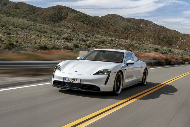 This undated photo provided by Porsche shows the 2020 Taycan. The Taycan is Porsche's first EV, and it's a multitalented one. You can use it just like a regular luxury sedan thanks to its four doors and two trunks, or you can drive it like a sports car and enjoy its rapid acceleration and hunkered-down handling. (Porsche Cars North America via AP)