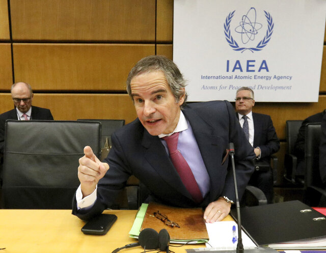 Director General of International Atomic Energy Agency, IAEA, Rafael Mariano Grossi from Argentina, talks prior to the start of the IAEA board of governors meeting at the International Center in Vienna, Austria, Monday, March 9, 2020. (AP Photo/Ronald Zak)