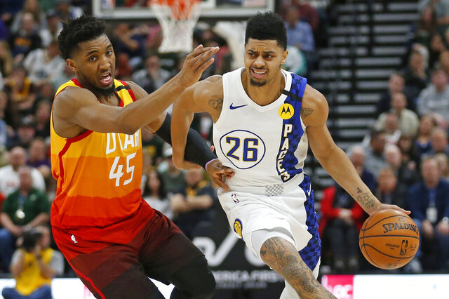 Utah Jazz guard Donovan Mitchell (45) guards Indiana Pacers guard Jeremy Lamb (26) in the first half during an NBA basketball game Monday, Jan. 20, 2020, in Salt Lake City. (AP Photo/Rick Bowmer)