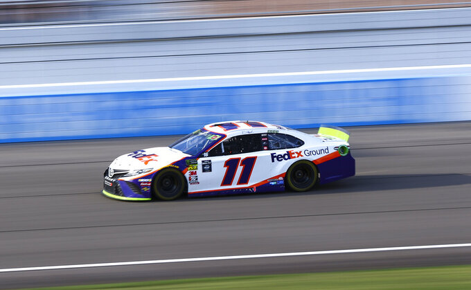Denny Hamlin (11) drives during a NASCAR Cup Series auto race at the Las Vegas Motor Speedway on Sunday, Sept. 15, 2019. (AP Photo/Chase Stevens)