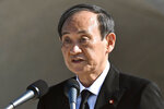 Japan's Prime Minister Yoshihide Suga delivers a speech during a ceremony at the Hiroshima Peace Memorial Park in Hiroshima, western Japan Friday, Aug. 6, 2021. Hiroshima on Friday marked the 76th anniversary of the world's first atomic bombing of the city. (Kyodo News via AP)