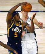Utah Jazz's Jarrell Brantley (5) draws a foul from San Antonio Spurs' Luka Samanic  (19) during the fourth quarter of an NBA basketball game Thursday, Aug. 13, 2020, in Lake Buena Vista, Fla. (Kevin C. Cox/Pool Photo via AP)