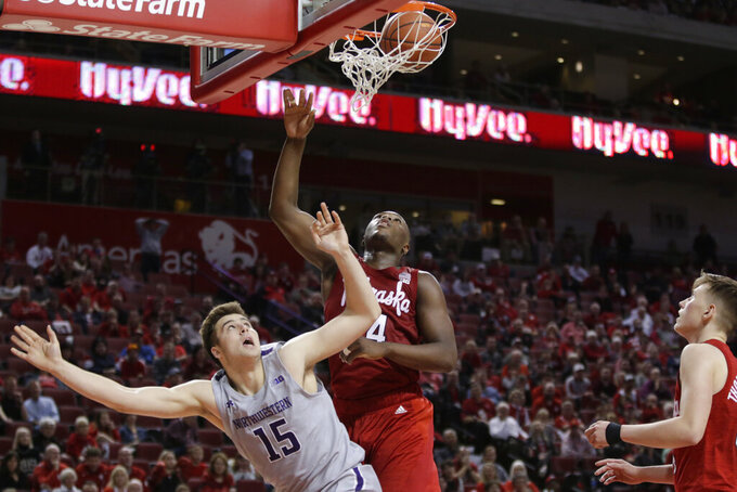 Northwestern's Ryan Young (15) watches his shot against Nebraska's Yvan Ouedraogo (24) during overtime in an NCAA college basketball game in Lincoln, Neb., Sunday, March 1, 2020. Northwestern won 81-76. (AP Photo/Nati Harnik)
