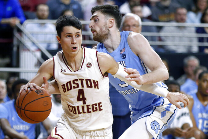Boston College's Chris Herren Jr. (4) drives past North Carolina's Andrew Platek (3) during the first half of an NCAA college basketball game in Boston, Tuesday, March 5, 2019. (AP Photo/Michael Dwyer)