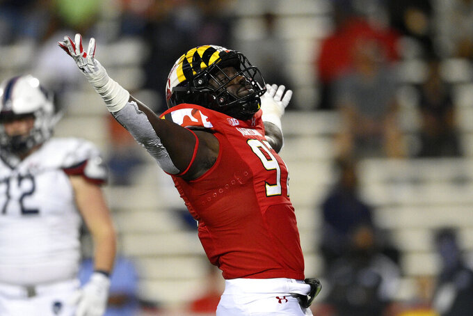 Maryland defensive lineman Sam Okuayinonu (97) reacts after he sacked Howard quarterback Undre Lindsay during the first half of an NCAA college football game, Saturday, Sept. 11, 2021, in College Park, Md. (AP Photo/Nick Wass)