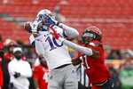 Texas Tech's Alex Hogan (27) breaks up a pass intended for Kansas' Tristan Golightly (10) during the first half of an NCAA college football game Saturday, Dec. 5, 2020, in Lubbock, Texas. (AP Photo/Brad Tollefson)
