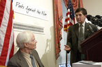 FILE -- In this March 5, 2003 file photo, U.S. Rep. Dennis Kucinich, D-Ohio, right, gestures toward Pulitzer Prize winning poet W.S. Merwin during a Capitol Hill news conference. Merwin, a prolific and versatile master of modern poetry who evolved through a wide range of styles as he celebrated nature, condemned war and industrialism and reached for the elusive past, died on Friday, March 15, 2019 at his home in Hawaii. A Pulitzer Prize winner and former U.S. poet laureate, Merwin completed more than 20 books and ranked high in the pantheon for decades, from early works inspired by myths and legends to late meditations on age and time. (AP Photo/Evan Vucci, File)