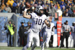 TCU quarterback Michael Collins (10) attempts a pass during the first half of an NCAA college football game against West Virginia, Saturday, Nov. 10, 2018, in Morgantown, W.Va. (AP Photo/Raymond Thompson)