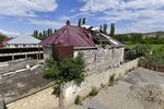 A damaged house is seen after shelling by Armenian forces in the Tovuz region of Azerbaijan, Tuesday, July 14, 2020. Skirmishes on the volatile Armenia-Azerbaijan border escalated Tuesday, marking the most serious outbreak of hostilities between the neighbors since the fighting in 2016. (AP Photo/Ramil Zeynalov)
