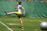 Green Bay Packers' punter JK Scott runs a drill during an NFL football minicamp Tuesday, June 8, 2021, in Green Bay, Wis. (AP Photo/Morry Gash)