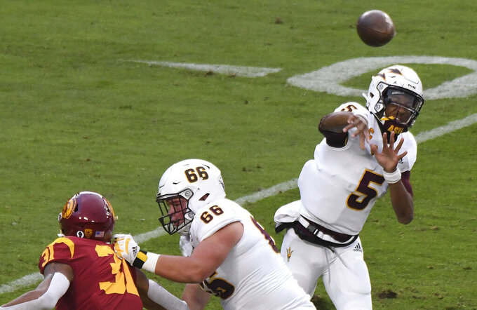 Quarterback Jayden Daniels #5 of the Arizona State Sun Devils passes against USC Trojans in the first half of a NCAA football game at the Los Angeles Memorial Coliseum in Los Angeles on Saturday, November 7, 2020. (Keith Birmingham/The Orange County Register via AP)
