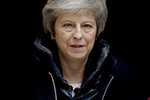 British Prime Minister Theresa May leaves 10 Downing Street in London, to attend Prime Minister's Questions at the Houses of Parliament, Wednesday, Nov. 21, 2018. (AP Photo/Matt Dunham)