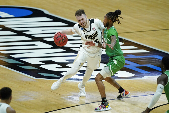 Purdue's Sasha Stefanovic (55) is defended by North Texas's James Reese (0) during the first half of a first-round game in the NCAA men's college basketball tournament at Lucas Oil Stadium, Friday, March 19, 2021, in Indianapolis. (AP Photo/Darron Cummings)