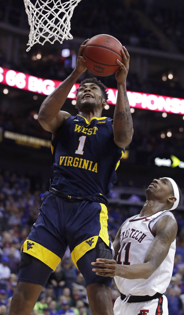 West Virginia's Derek Culver (1) gets past Texas Tech's Tariq Owens (11) for a shot during the second half of an NCAA college basketball game in the Big 12 men's tournament Thursday, March 14, 2019, in Kansas City, Mo. West Virginia won 79-74. (AP Photo/Charlie Riedel)