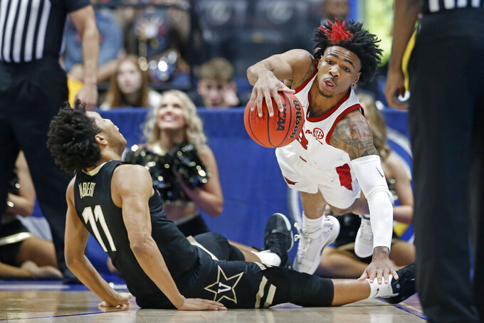 Arkansas guard Desi Sills, right, collides with Vanderbilt guard Braelee Albert (11) in the first half of an NCAA college basketball game in the Southeastern Conference Tournament Wednesday, March 11, 2020, in Nashville, Tenn. (AP Photo/Mark Humphrey)
