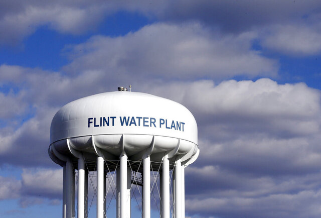 FILE - In this March 21, 2016, file photo, the Flint Water Plant water tower is seen in Flint, Mich. Former Michigan Gov. Rick Snyder, Nick Lyon, former director of the Michigan Department of Health and Human Services, and other ex-officials have been told they're being charged after a new investigation of the Flint water scandal, which devastated the majority Black city with lead-contaminated water and was blamed for a deadly outbreak of Legionnaires' disease in 2014-15, The Associated Press has learned. (AP Photo/Carlos Osorio, File)