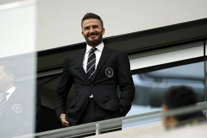 David Beckham looks on from the stands before an MLS soccer match between Los Angeles FC and Inter Miami CF Sunday, March 1, 2020, in Los Angeles. (AP Photo/Marcio Jose Sanchez)