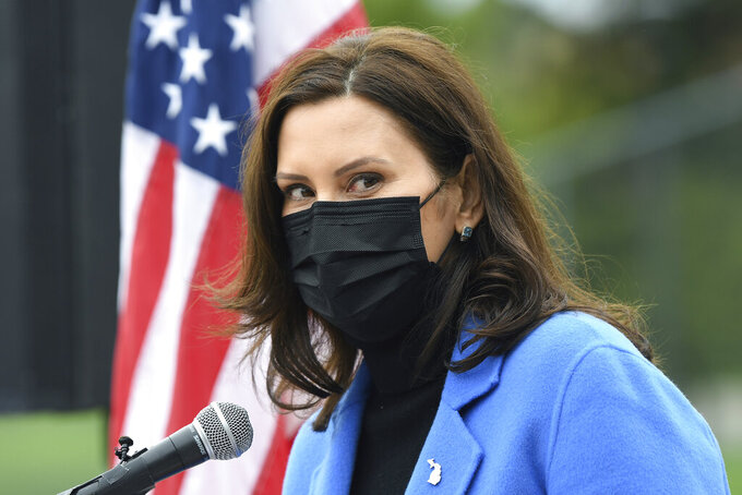 File-This April 12, 2021, file photo shows Michigan Governor Gretchen Whitmer talking about the statewide COVID-19 vaccination effort during a press conference, in Ypsilanti, Mich. Whitmer is facing renewed scrutiny after reports that she used a private plane shared by high-powered, politically connected Detroit-area business families to visit her elderly father in Florida in March. (Lon Horwedel/Detroit News via AP, File)/Detroit News via AP)