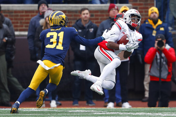 No. 2 Ohio State beats No. 10 Michigan 56-27 for record run