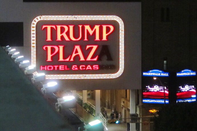 This Sept. 10, 2014 photo shows a partially burned-out sign on the exterior of the Trump Plaza casino in Atlantic City, N.J. On Monday, Jan. 18, 2021, an auction house soliciting bids for the right to press the button to implode the shuttered casino stopped the effort after receiving a cease-and-desist letter from billionaire Carl Icahn, who owns the property. Icahn says the auction would have promoted something he considered to be a safety risk, and said he will replace the $175,000 that would have gone to the Boys Girls Club of Atlantic City. (AP Photo/Wayne Parry)