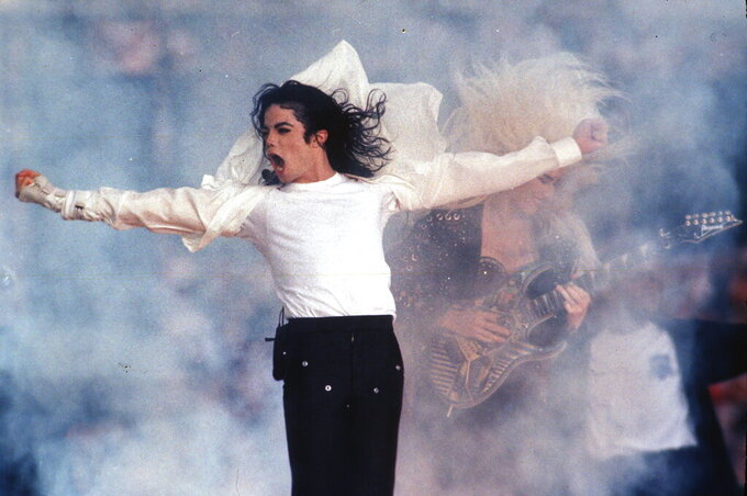 "FILE - This Feb. 1, 1993 file photo shows Pop superstar Michael Jackson performing during the halftime show at the Super Bowl in Pasadena, Calif. A stage musical about Michael Jackson has pushed its Broadway debut until next year due to the coronavirus pandemic. Preview performances of ""MJ"" are now set to begin in March 2021 at the Neil Simon Theatre. (AP Photo/Rusty Kennedy, file)"