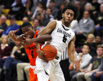 Oregon State forward Alfred Hollins, left, fights for control of a rebound with Colorado guard D'Shawn Schwartz in the second half of an NCAA college basketball game Thursday, Jan. 31, 2019, in Boulder, Colo. (AP Photo/David Zalubowski)
